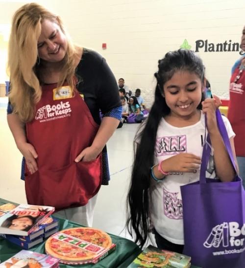 Merryn Walker volunteers during 2017 books distributions